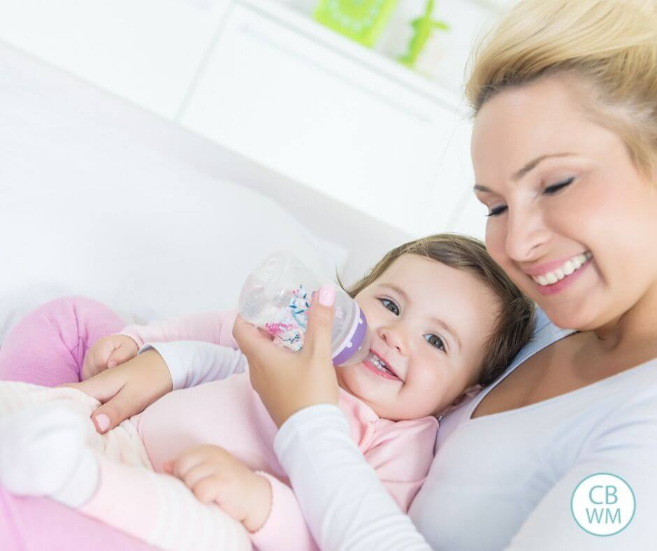 Mom feeding her baby on a schedule