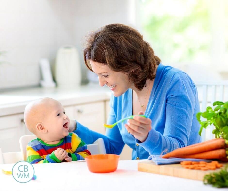 Mom feeding baby solid foods
