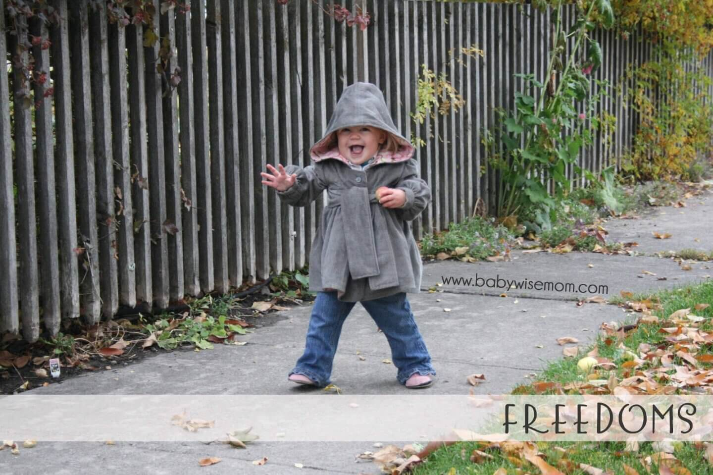 Toddler walking down the sidewalk