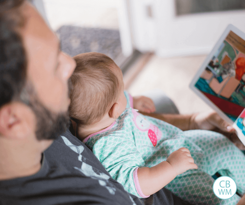A dad reading to his baby