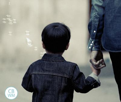 Child walking holding parent's hand