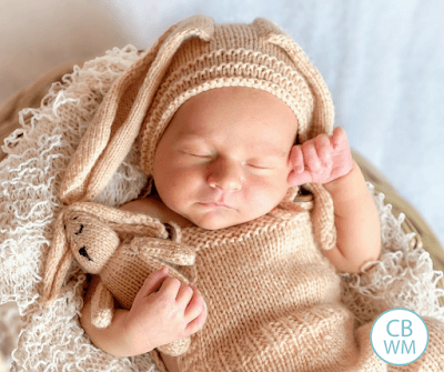 Newborn baby sleeping wearing a crocheted bunny costume