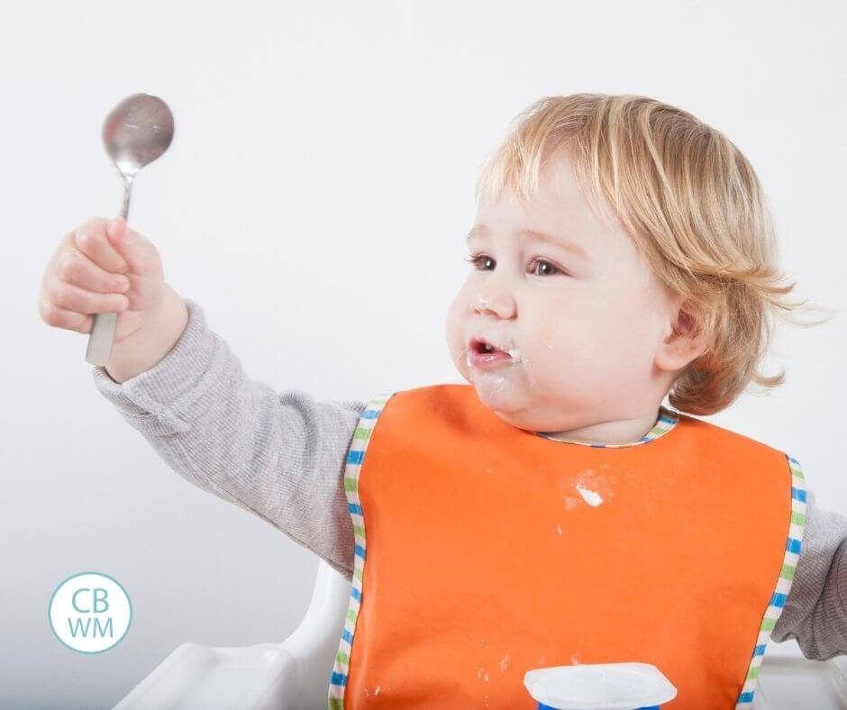 Toddler eating with a spoon
