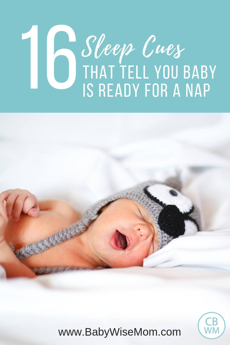 16 Sleep Cues that tell you baby is ready for a nap with a picture of a sleeping baby on white bedding