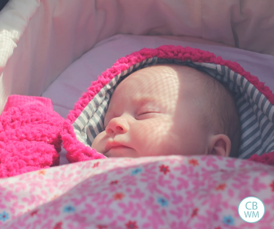 Newborn baby sleeping in bassinet