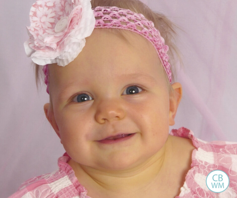 12 month old girl dressed in pink