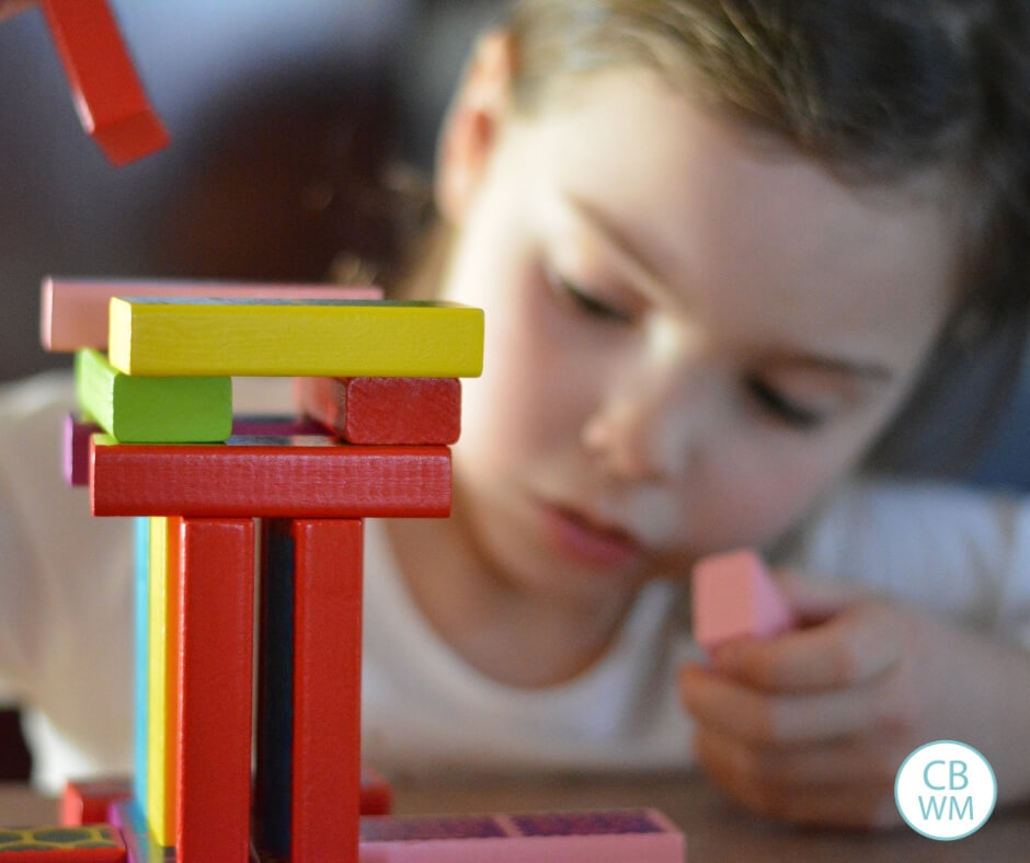 Girl playing with blocks independently