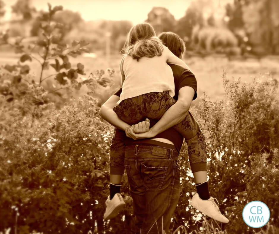 Picture of a girl getting a piggy back ride taken in sepia tone