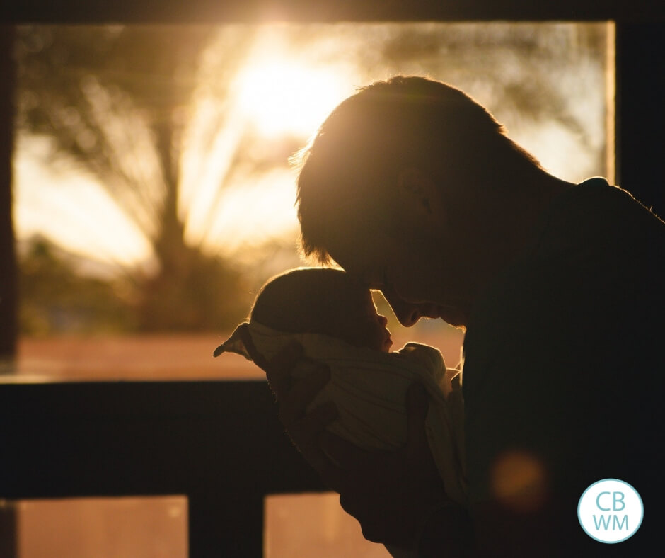 Father holding baby silhouette