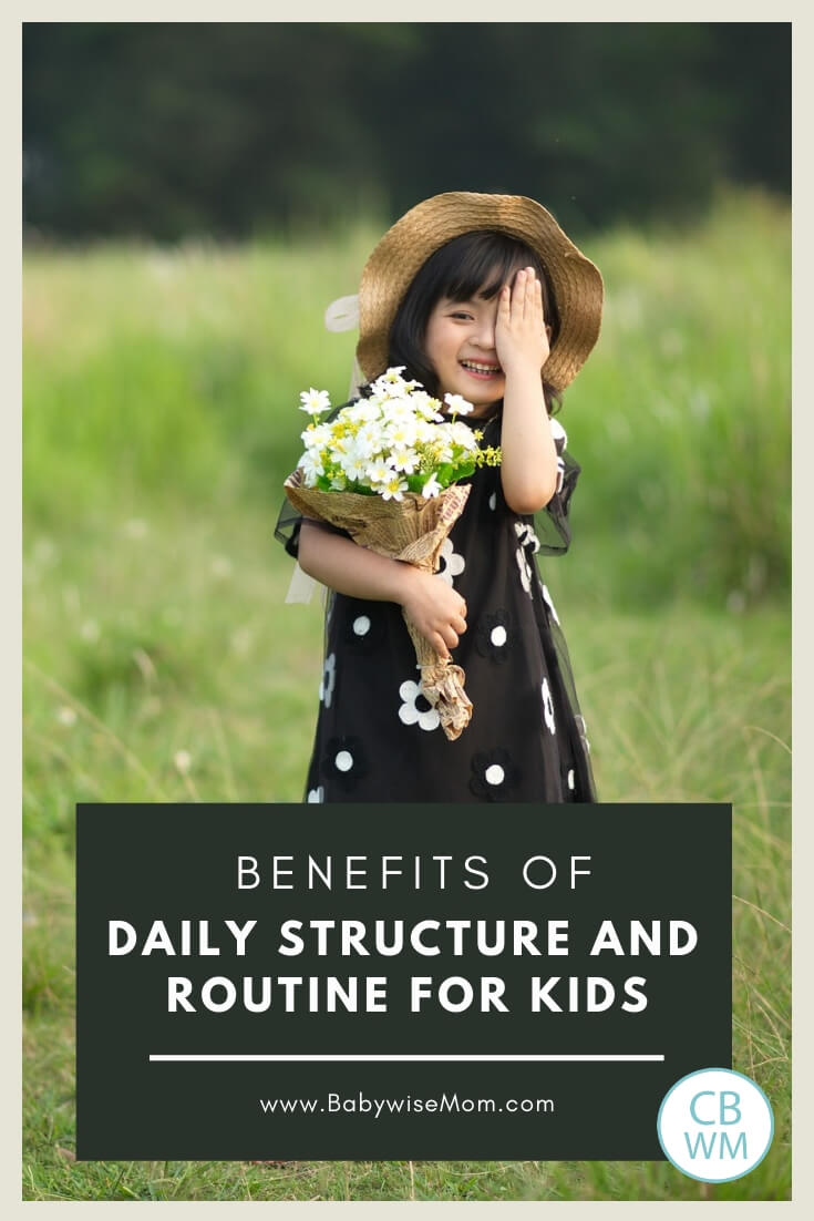 Girl standing in a green meadow holding flowers with a text overlay reading benefits of structure and routine for kids