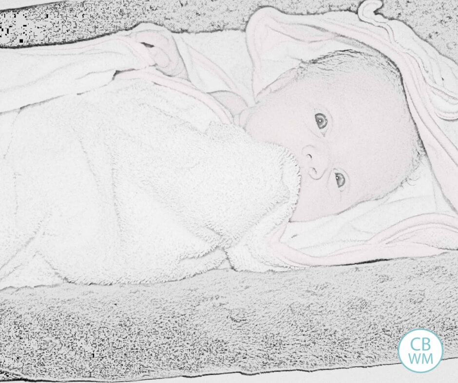 6 week old baby wrapped up in a towel