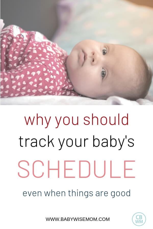 Why you should track your baby's schedule and picture of baby in pink outift