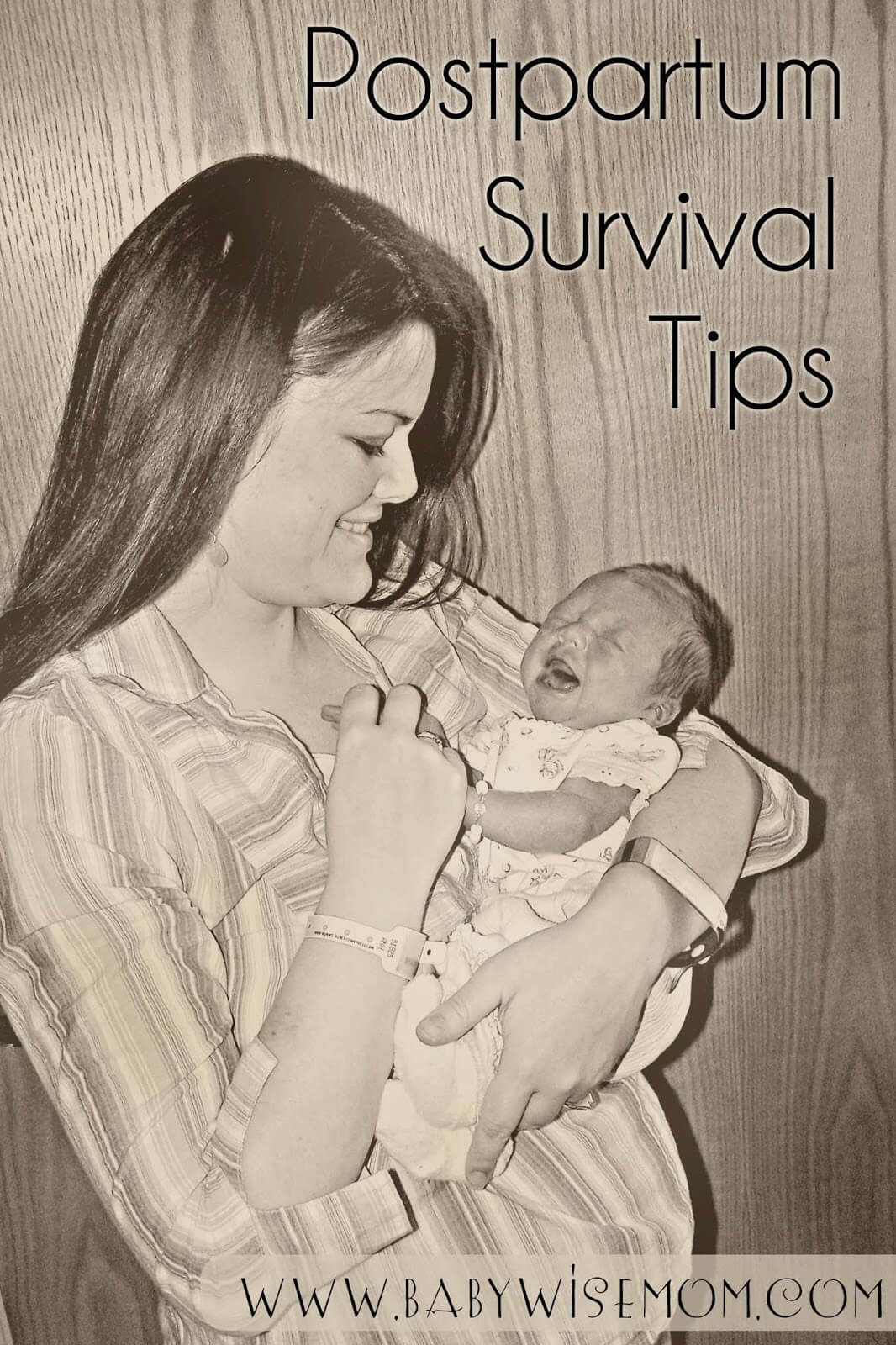 Mom holding her newborn baby.