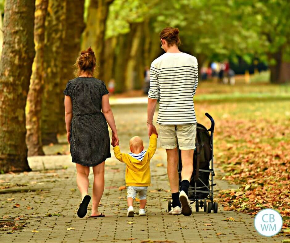 parents walking with young child