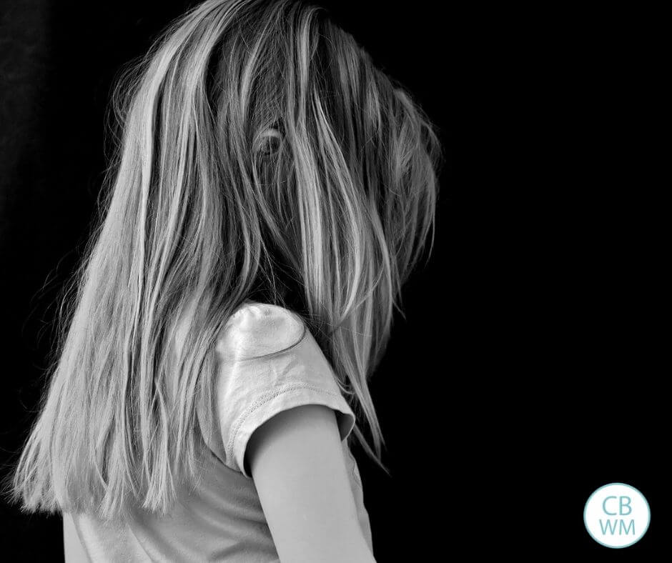 Child with her back to the camera in black and white
