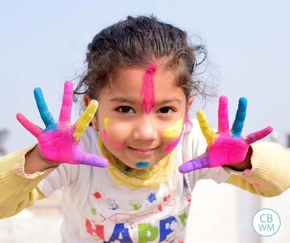 preschooler with messy hands enjoying play