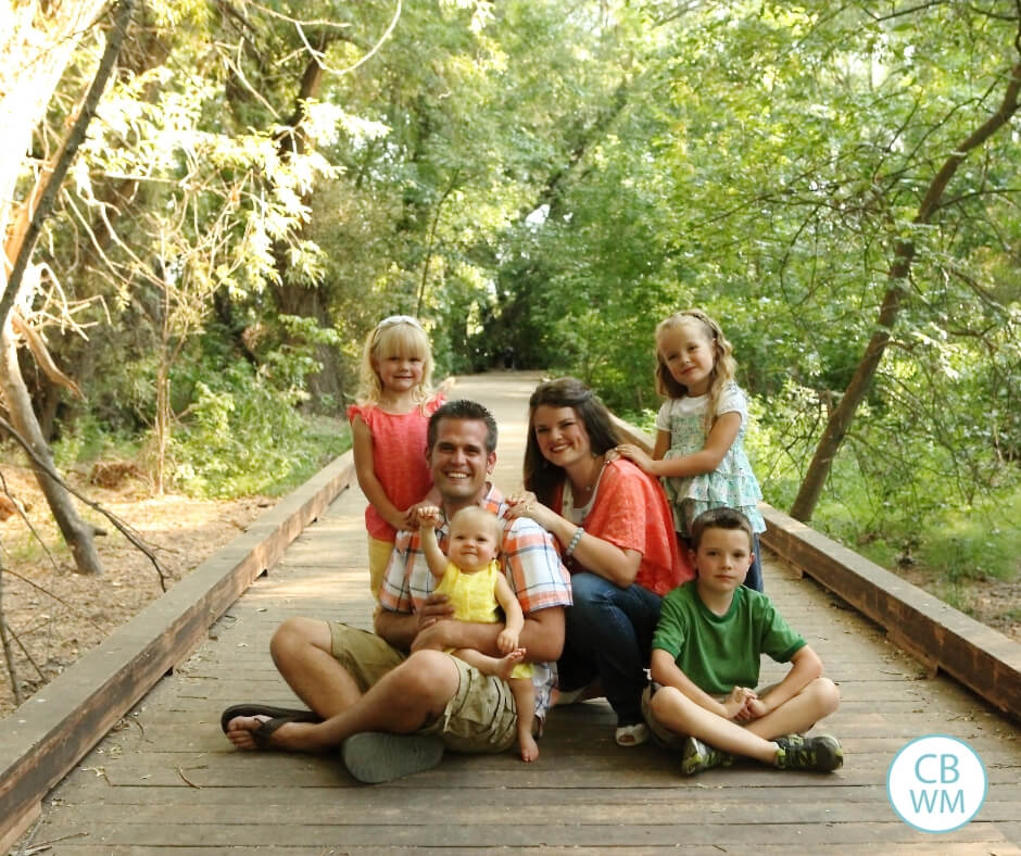 Family on a bridge in the woods