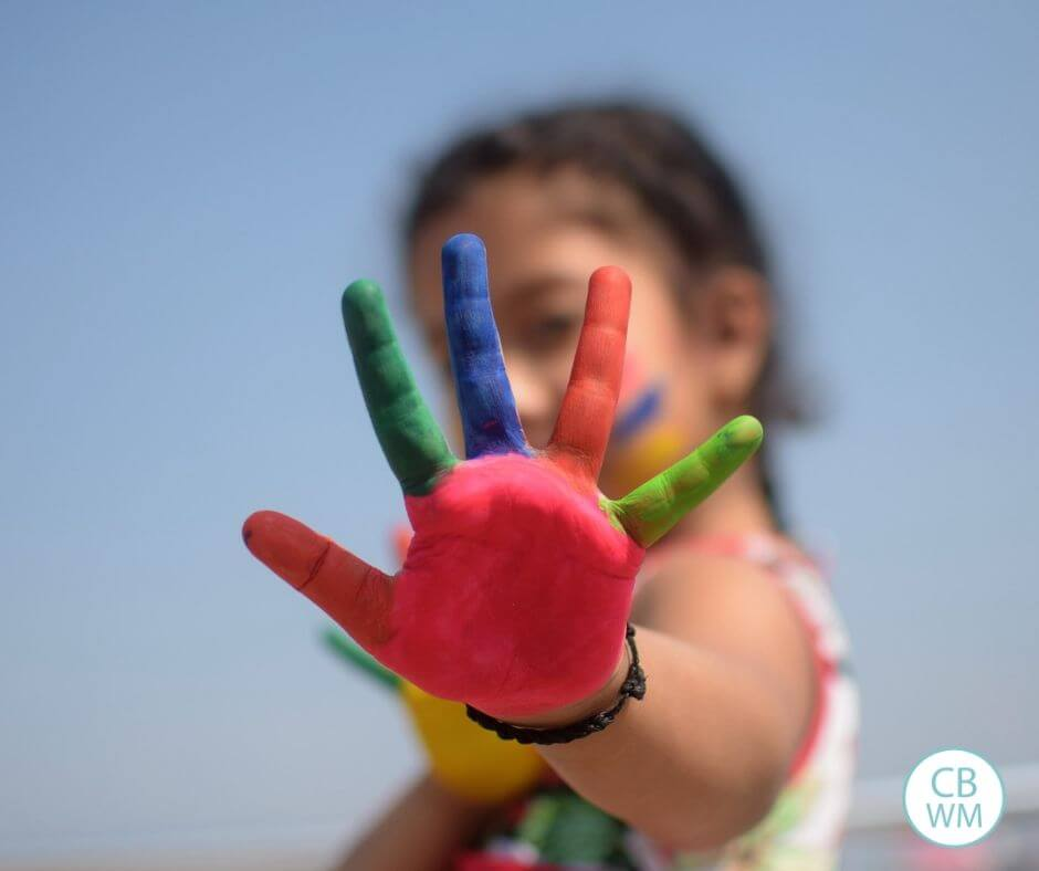 Girl holding up a painted hand