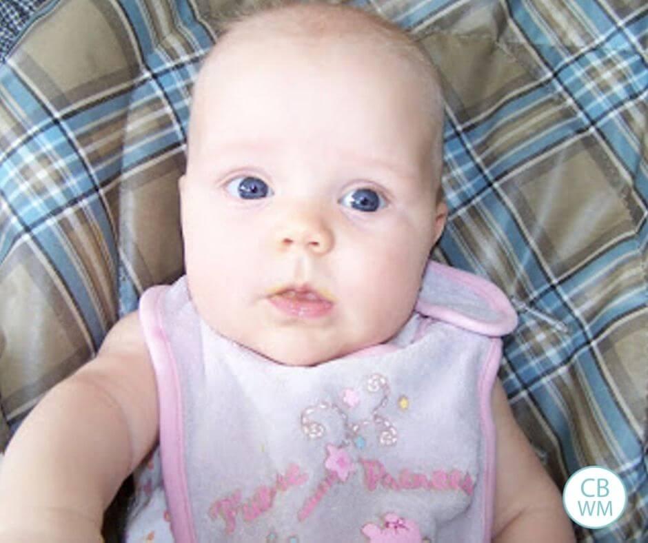 25 week old baby McKenna sitting in a high chair
