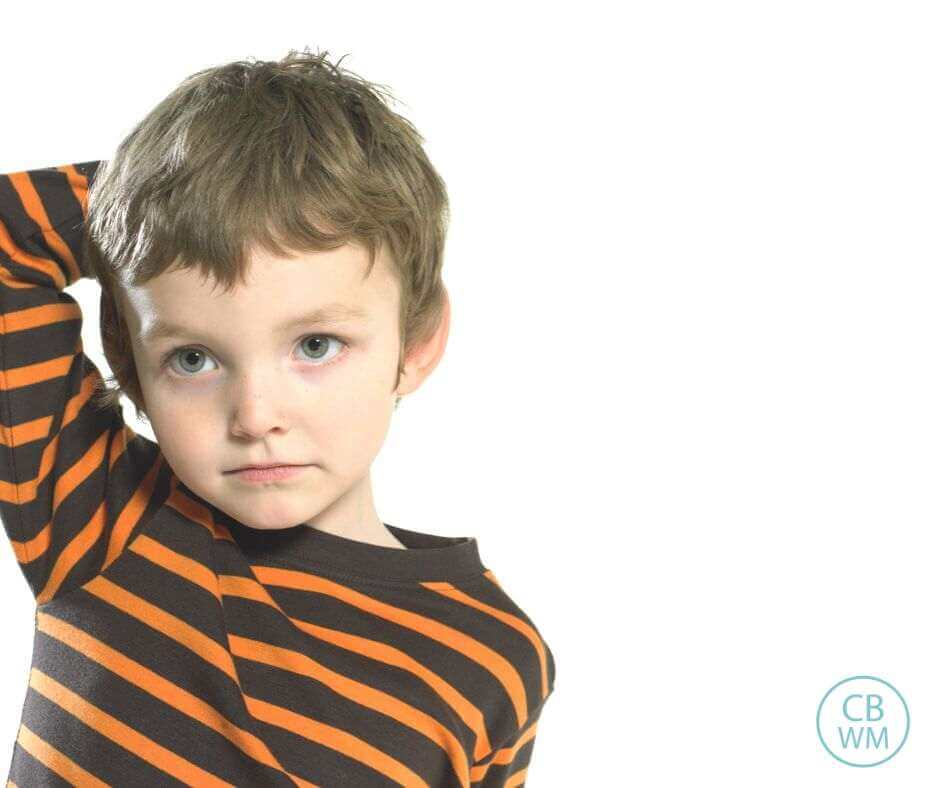 Preschooler looking confused with a solid white background