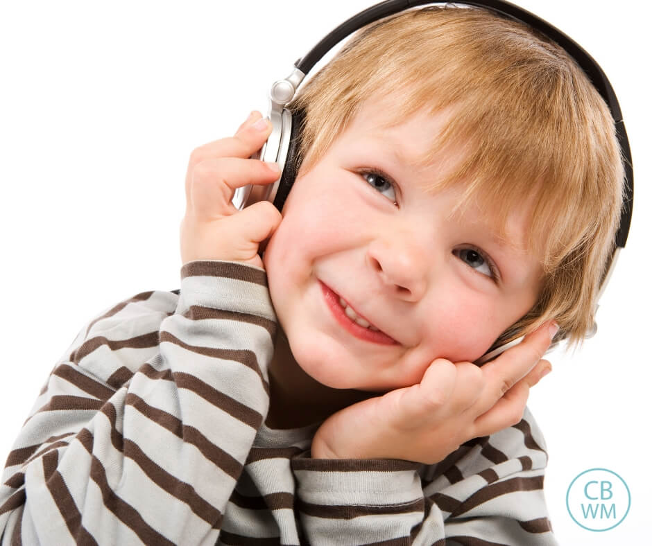Child listening to headphones