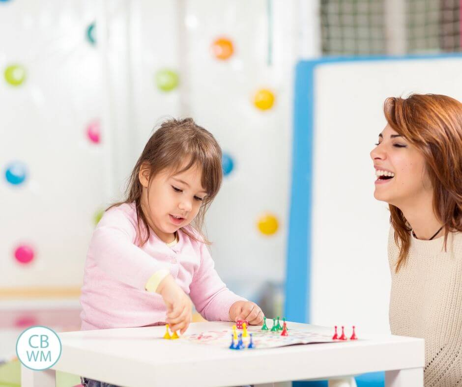 Mother and preschooler playing a game together