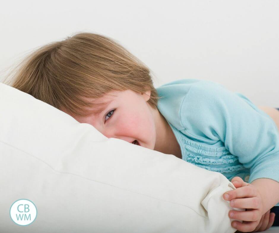 Crying toddler with face in a pillow