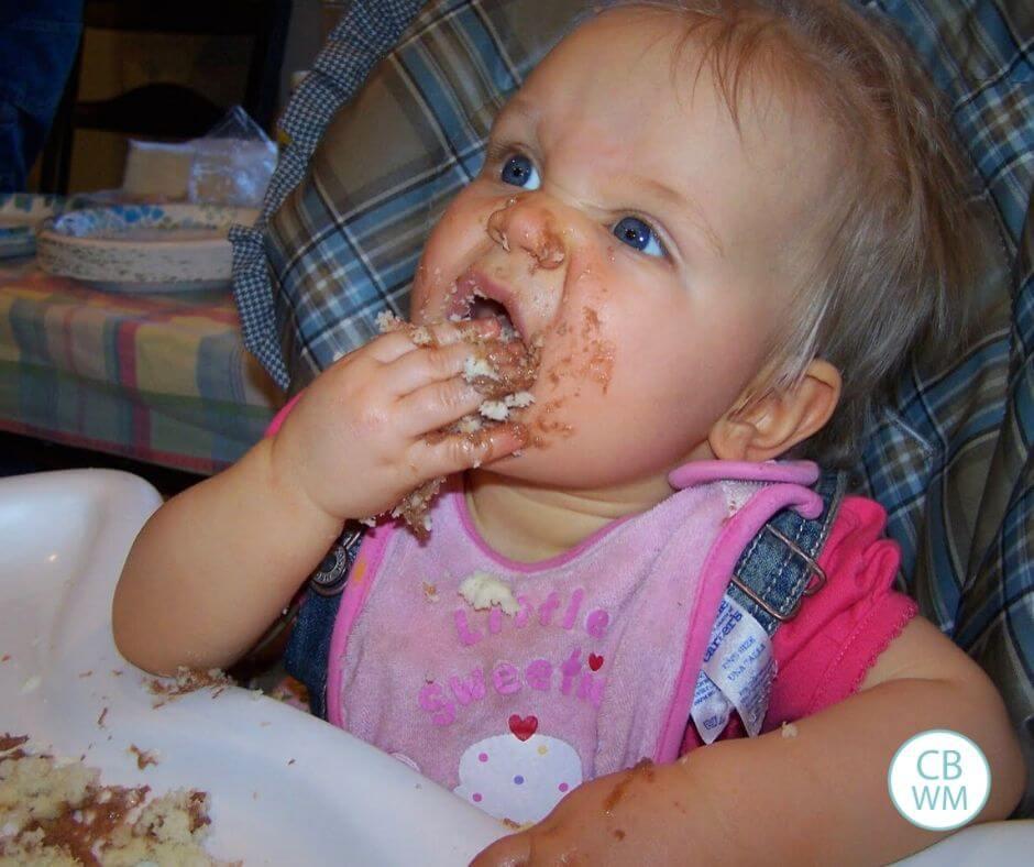 12 month old McKenna eating cake