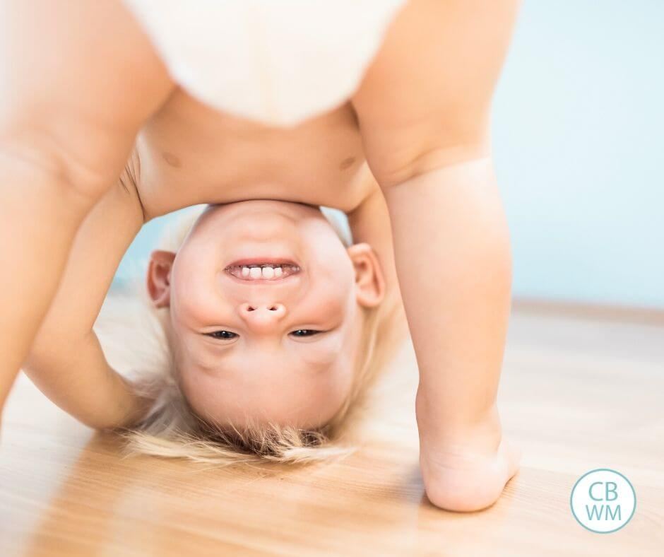 Pretoddler being silly and looking upside down