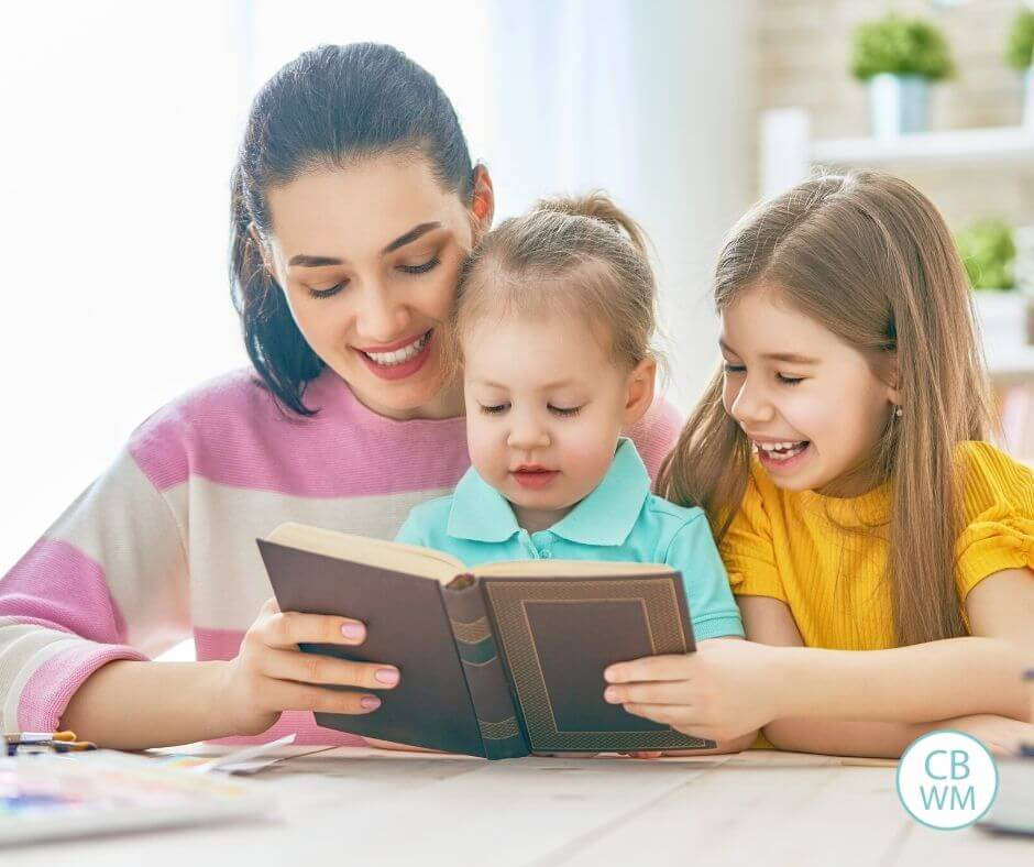Mom reading with two children