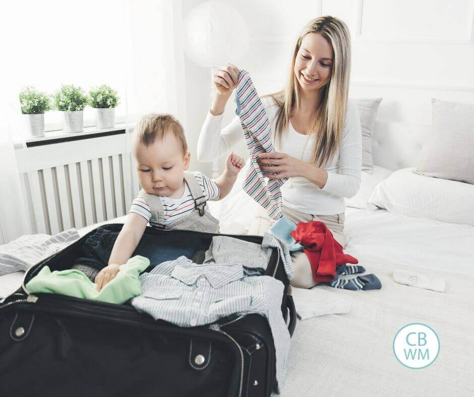 Mom packing for a vacation with her baby