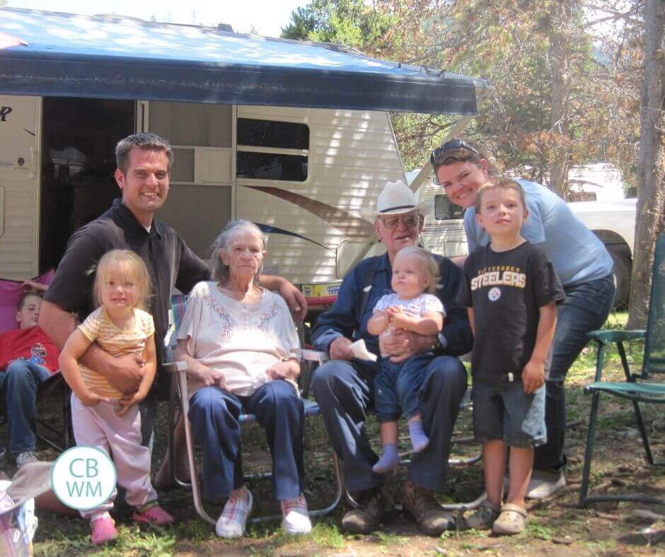 family in front of camper