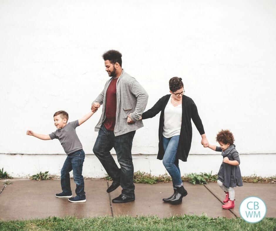 Family walking along having fun