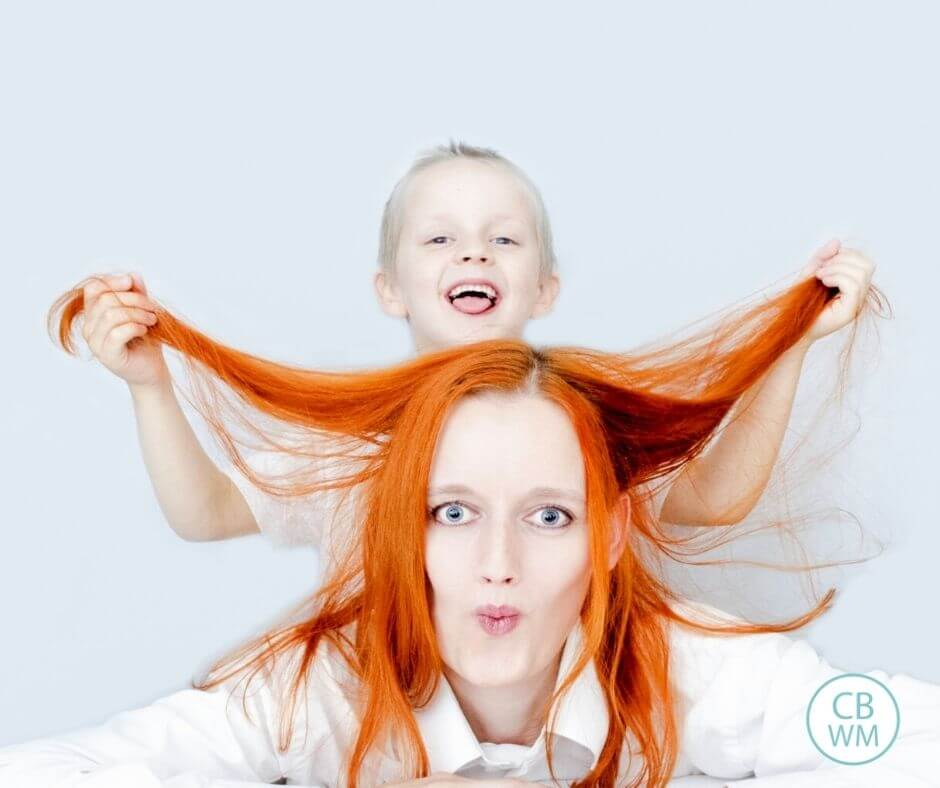 Mom and child pulling on her hair