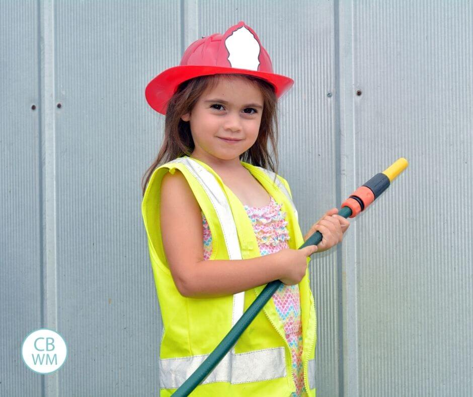 Child learning fire safety at home