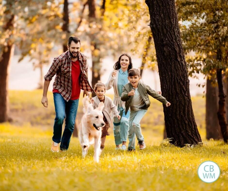 Family running through the park