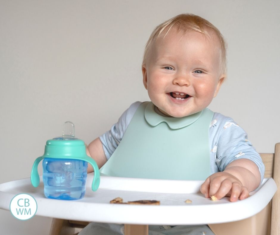 Child eating breakfast in high chair