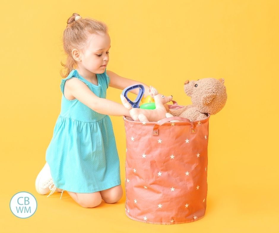 Girl with bin of toys