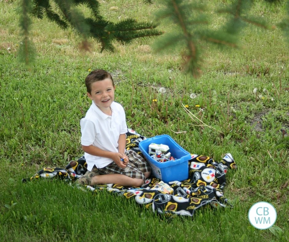 6 year old Brayden playing LEGOS outside