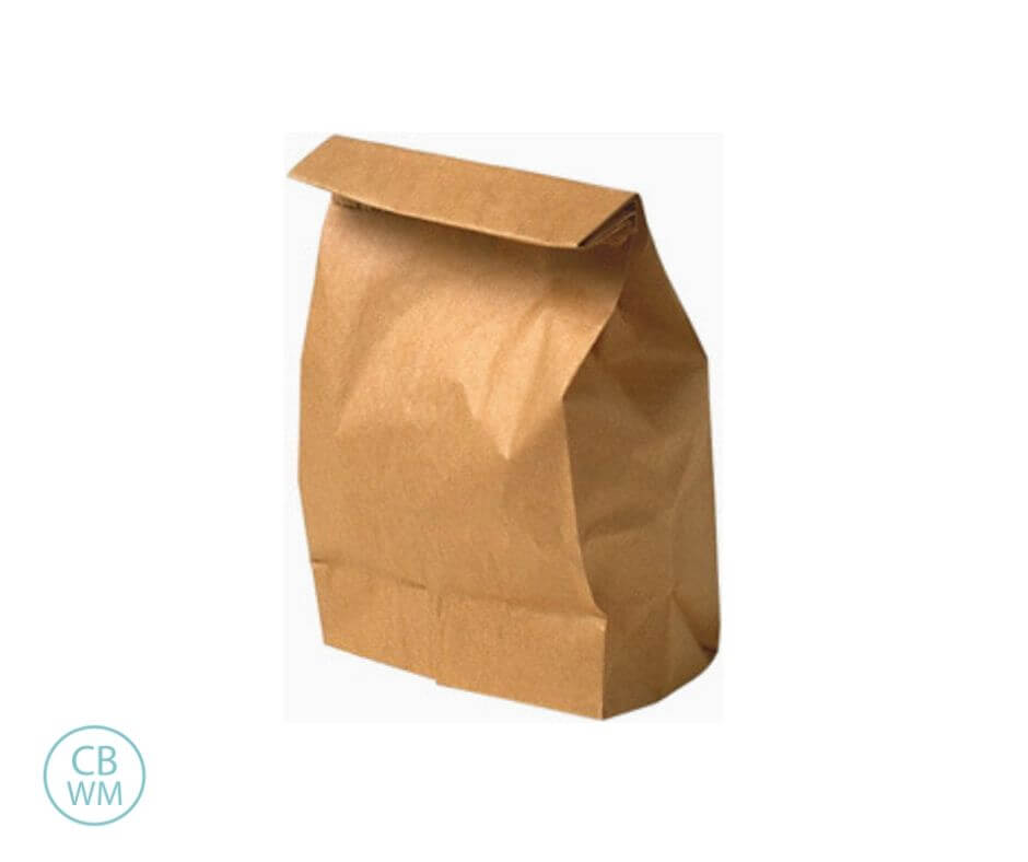Brown paper bag filled with food