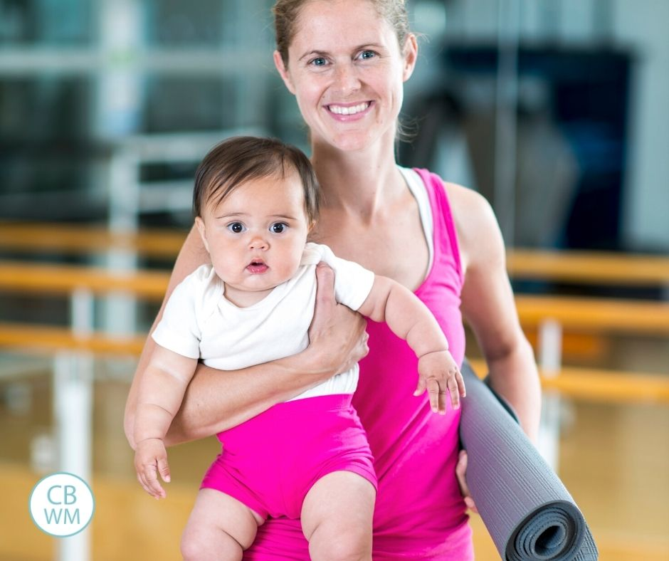 Mom ready to exercise holding a baby