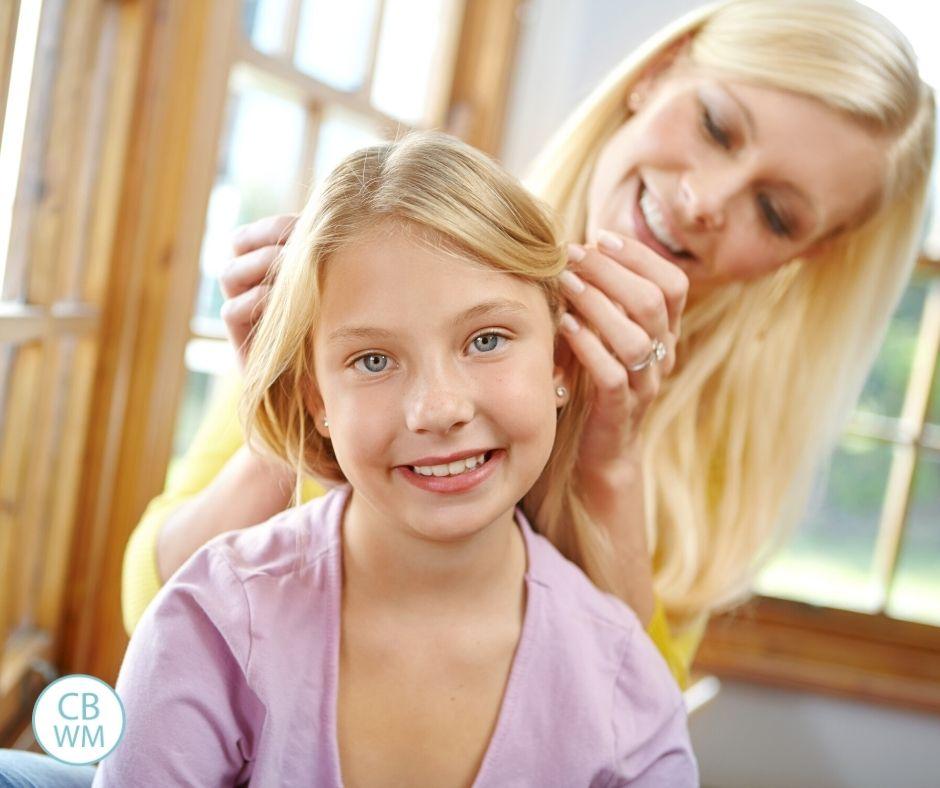 Mom doing daughter's hair