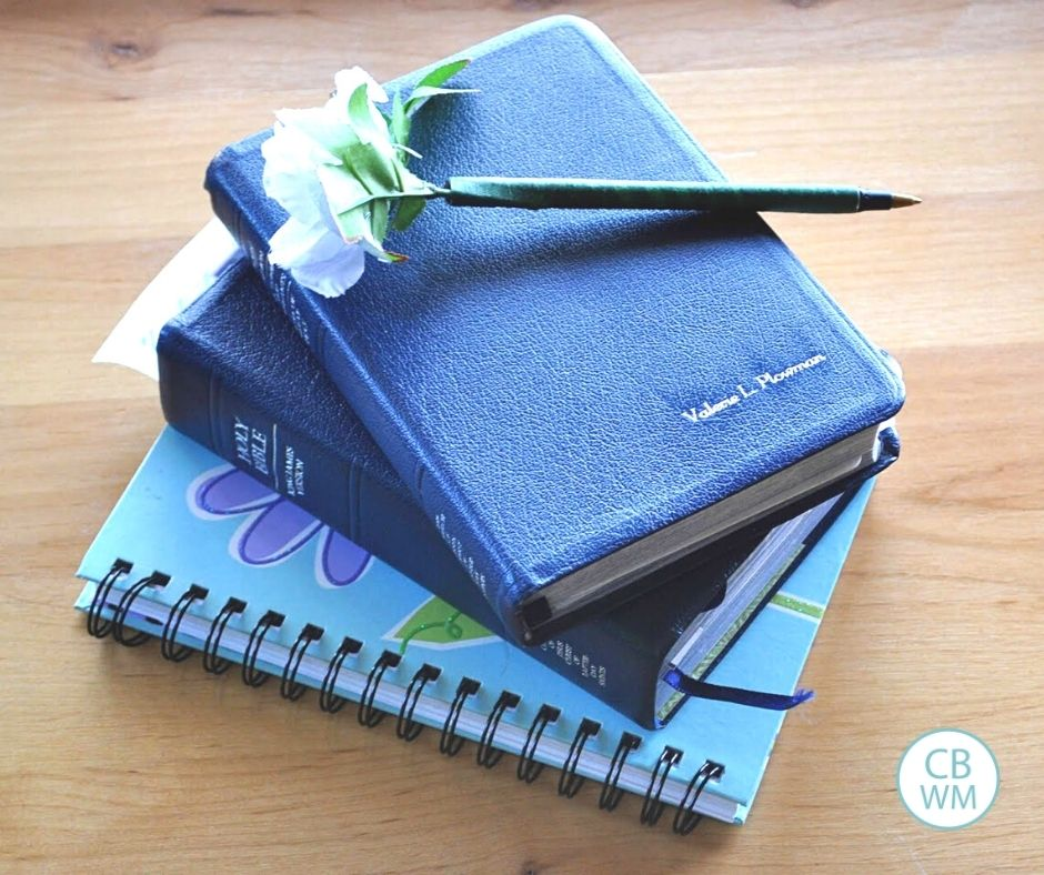 Scriptures and a scripture journal in a stack