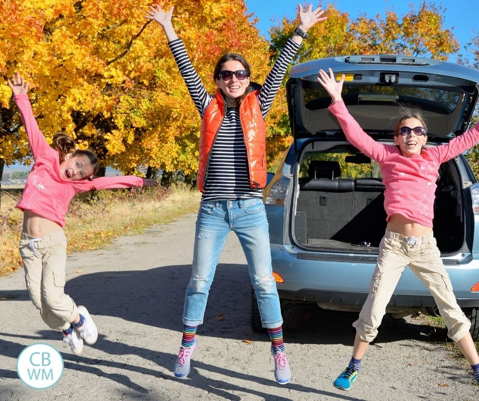 Mom celebrating with kids by jumping in air outside