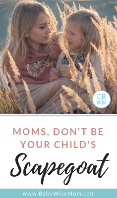 Don't Be Your Child's Scapegoat words and a picture of a mother and daughter sitting in a field