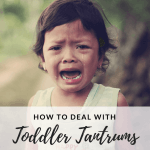 How to Deal with Toddler Tantrums with a picture of a toddler having a tantrum