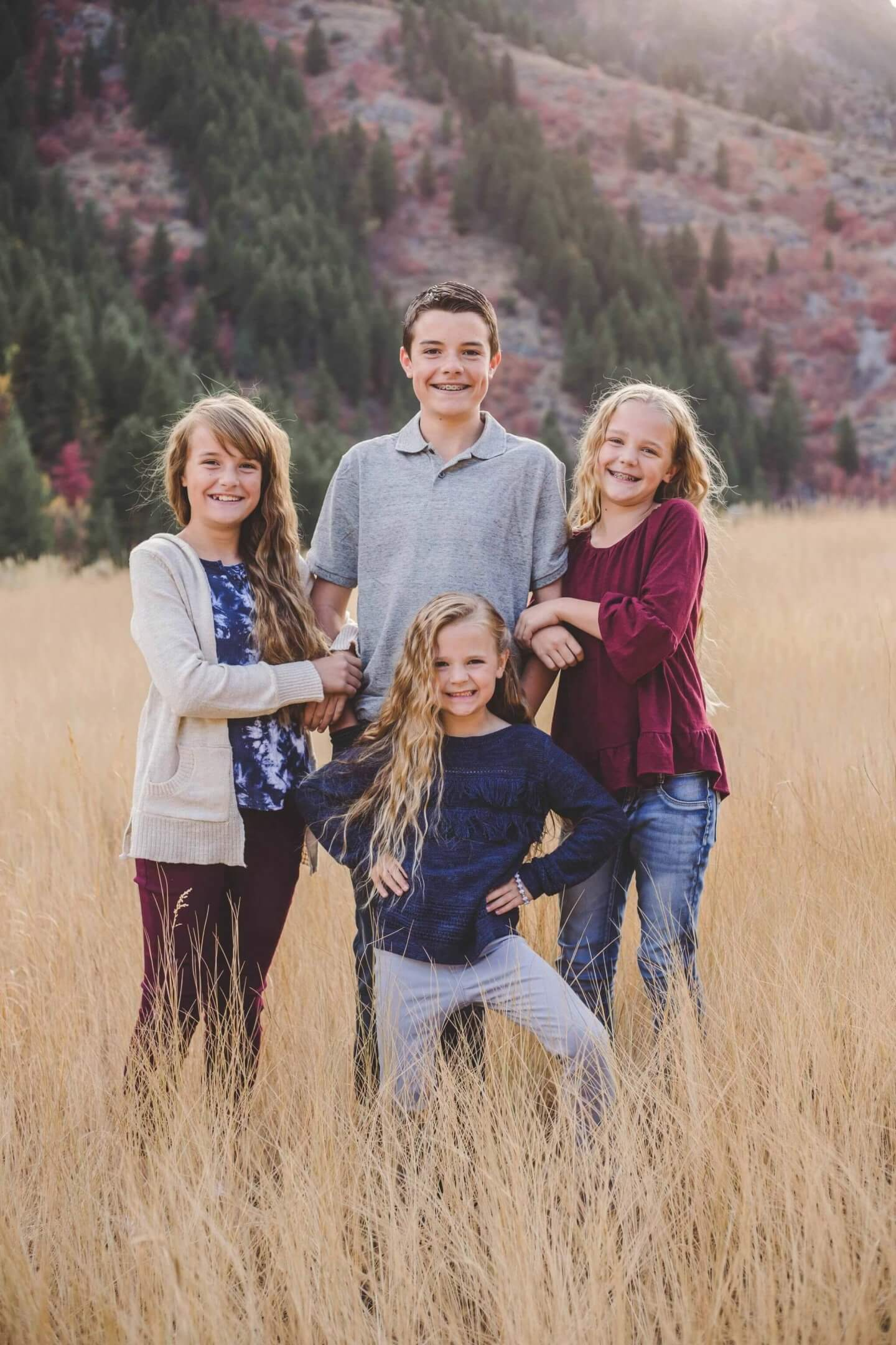 Family photos. Four children in the mountains.
