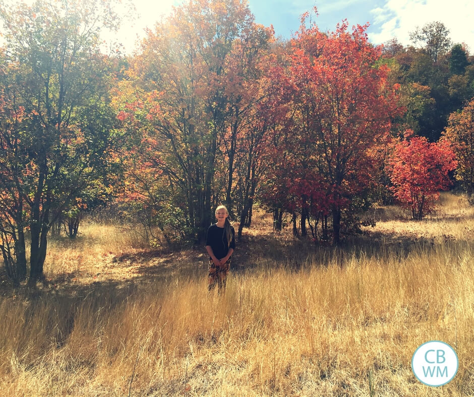 McKenna in the mountains with fall foliage