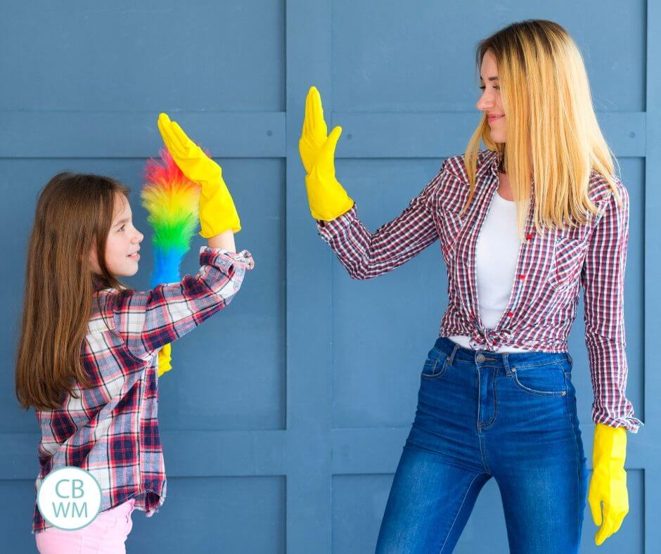 Mother teaching her daughter how to do chores