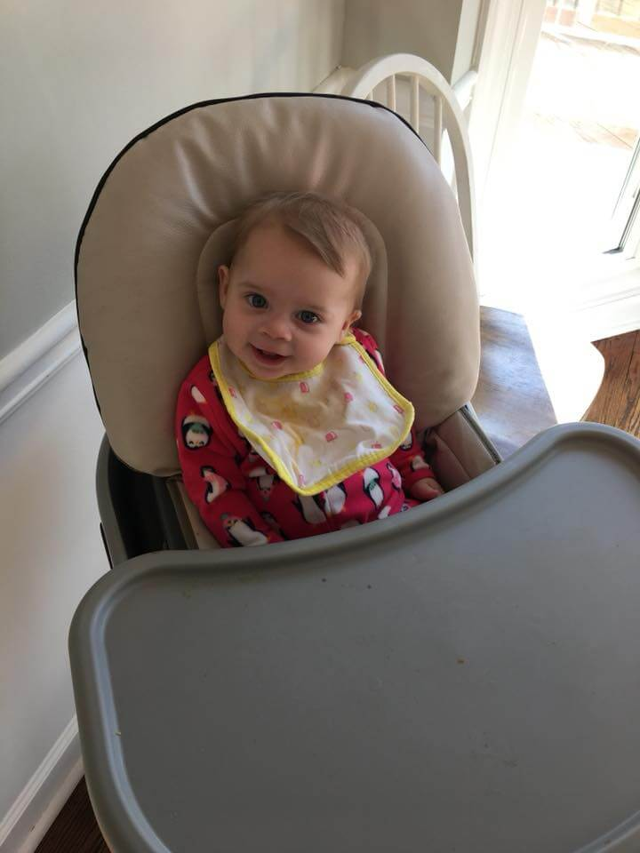 7 month old baby sitting in high chair